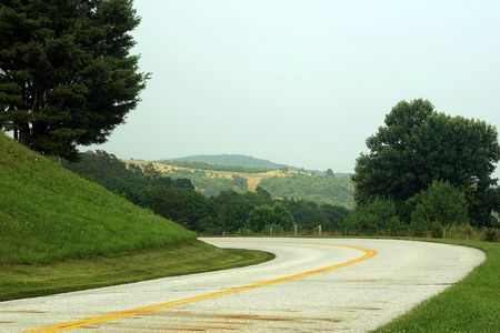 A curvy road with a beautiful view. photo