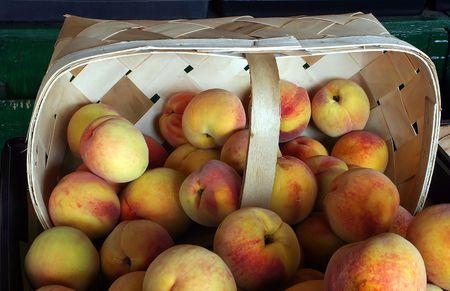 Peaches in an open air market. photo