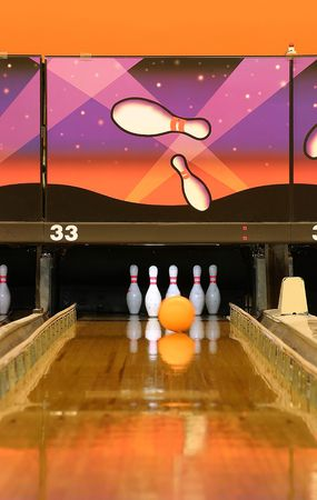 gutter: A bowling alley.  Gutter guards are up and ball is heading to the pins Stock Photo