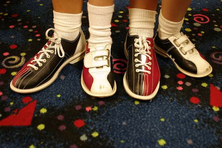 big foot: Two pair of bowling shoes..adult and child. Stock Photo