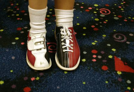 Bowling shoes.. one of each, diffrent sizes. photo