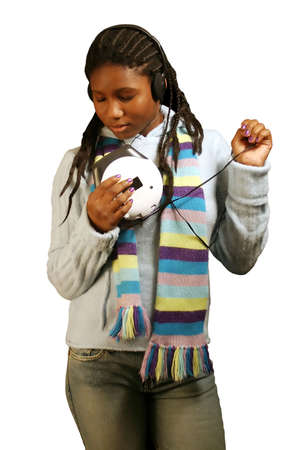 A beautiful teenage girl listening to music with her eyes closed. With clipping path. photo