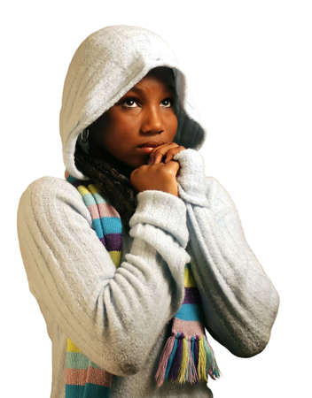 A teenage girl praying.  Isolated with clipping path. photo