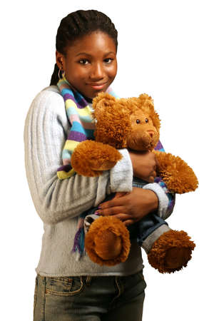 undefined: A teenage girl hugging a teddy bear. With clipping path.