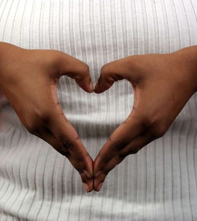 forming: Hands in the shape of a heart. Stock Photo