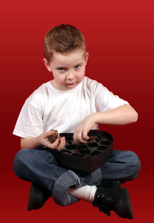 A little boy caught in the candy. Stock Photo - 305535