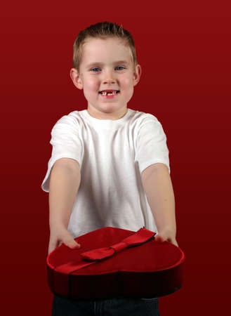A little boy offering a Valentines gift. Stock Photo - 305538