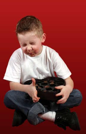 A little boy tasting candy that he REALLY doesn't like! Standard-Bild
