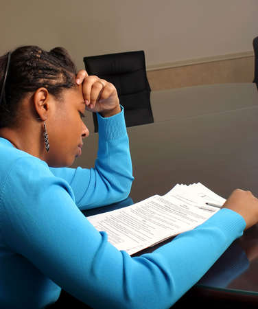 A young woman reading forms. photo