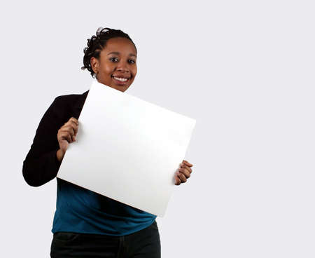 A young woman holding a blank sign. Reklamní fotografie