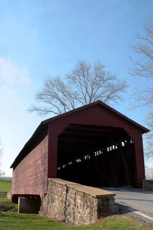 md: Utica Mills covered bridge in Fredrick, MD Vertical Stock Photo