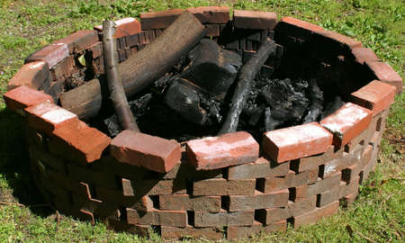 A fire pit in the day time.