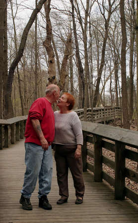 A mature couple stop for a kiss. Stock Photo - 390752