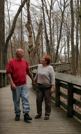 A mature couple talking and taking a walk.