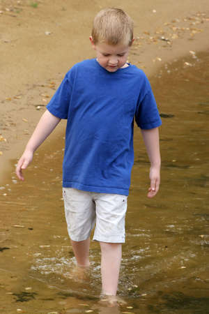 A child wading in a lake. Stock Photo - 405458