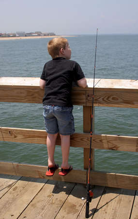 A little boy waiting for a fish to bite. Stock fotó