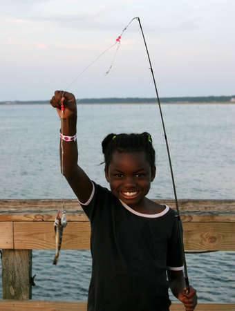 A little girl and her fish. photo