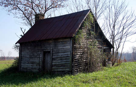A cabin in a field.