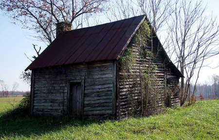 unloved: A cabin in a field.