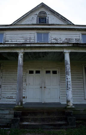 unloved: An abandoned country house.