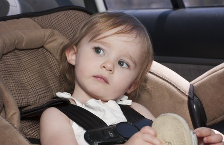 Toddler in Carseat in back of car photo