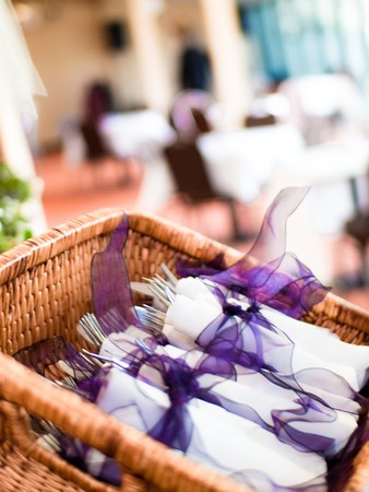 Basket of Place Settings with Distant Tables