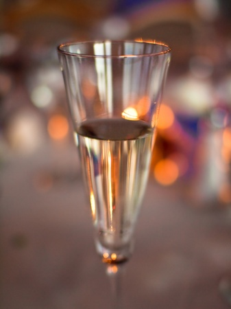 A beautifully lit champagne glass with an abstract looking background