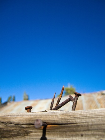 Rusty old nails and big blue sky