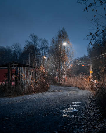 Autumn night scene of a dirt road and puddles Stok Fotoğraf