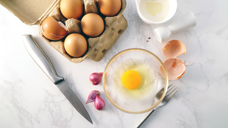Fresh egg yoke in a bowl on top view Stock Photo