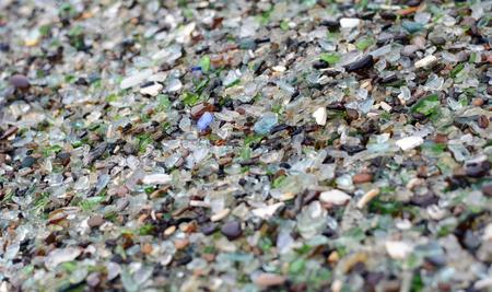 shore of glass and porcelain fragments Reklamní fotografie
