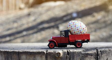 car carrying Easter egg
