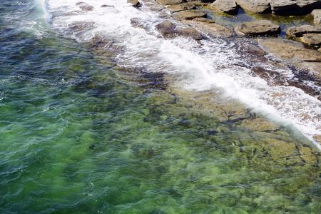bright deep lagoon and waves 写真素材