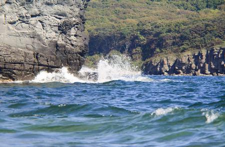 sea waves crashing against rocks
