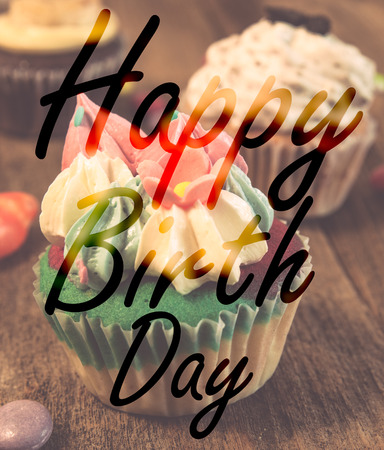 goodluck: Happy birth day cupcake on wood table