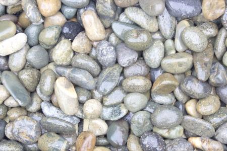pebble stones background. closeup of stones texture photo