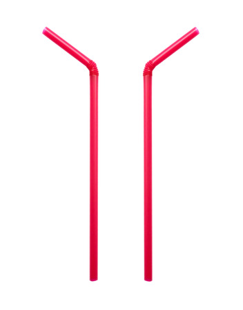 Two red straw on white background. photo