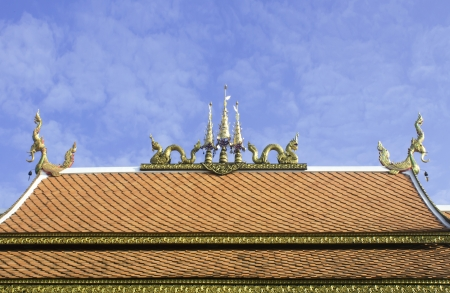 ornately: detail of ornately decorated temple roof in lamphun, thailand