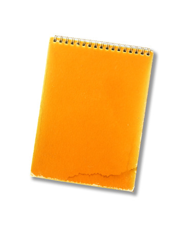 Old note book on white background.  photo