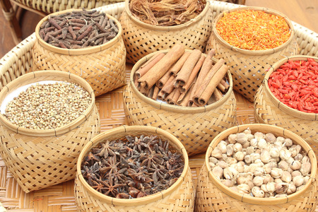Spices, herbs in bamboo basket photo