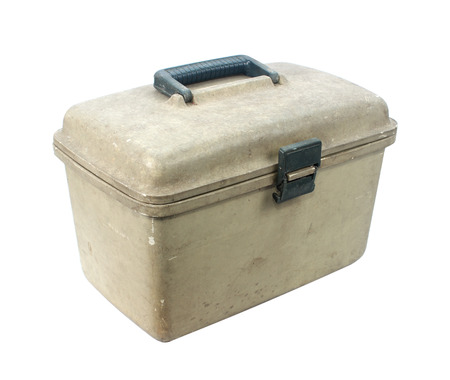 Old plastic toolbox on white.  photo