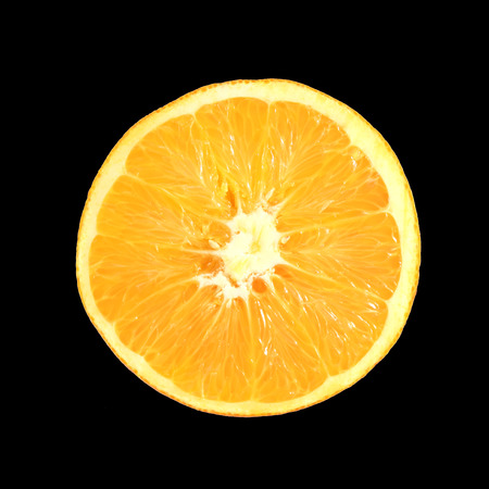 orange cut: orange cut isolated on black with clipping path