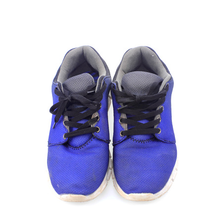 Old sneakers on white background photo