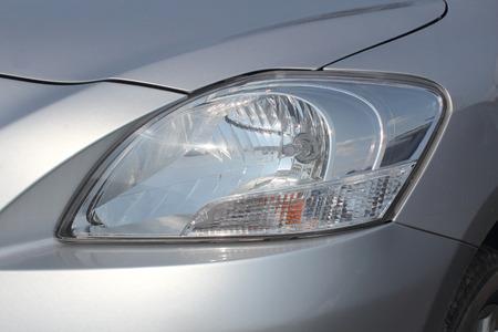 12v: Closeup of car headlight