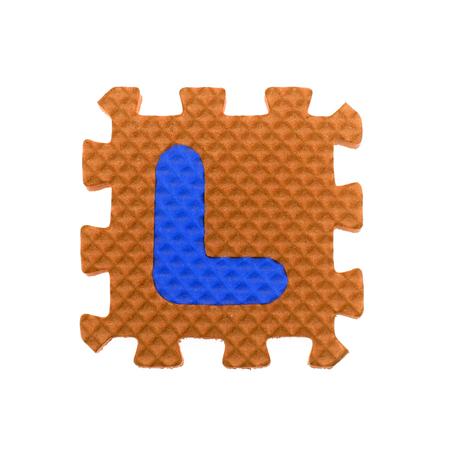 l hand: Alphabet L puzzle pieces on white background Stock Photo