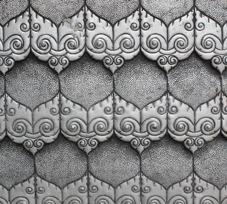 lanna: metal pattern Crafts wall in the temple of thailand, Lanna style Chiang Mai, Thailand.
