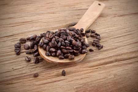 coffee beans: Coffee beans whit wooden spoon on wood