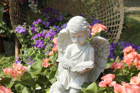 statuary garden: stone angel doll in garden