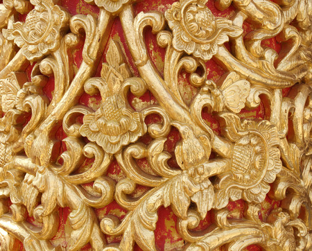 r image: Pattern of wood carve gold paint for decoration