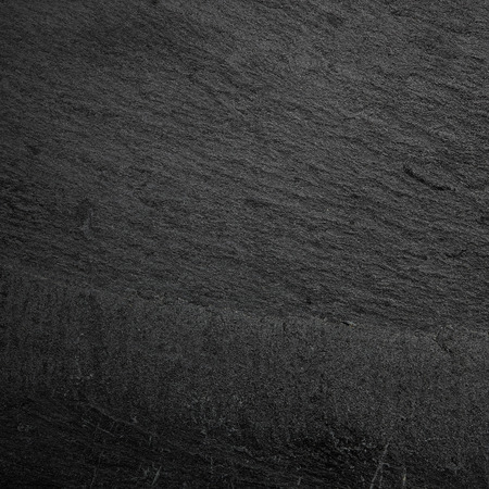 luz natural: pizarra de fondo negro o textura Foto de archivo